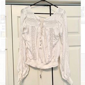 White blouse with lace embellishments